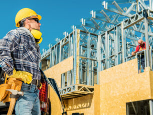 Skeleton,Steel,House,Building.,Construction,Business,Concept.,Caucasian,Worker,In